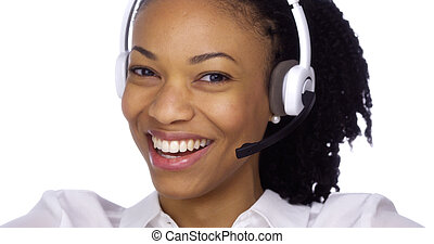 Black businesswoman smiling with headset