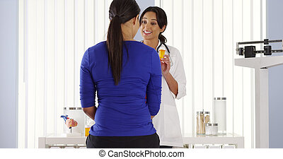 Hispanic physician talking to patient about new prescription