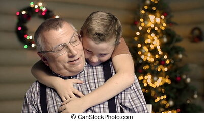 Affectionate Embrace - Waist up shot of grandson hugging his...