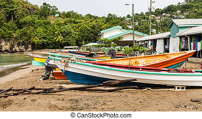 Colorful Fishing Boats on Beach Behind old Houses - Colorful...