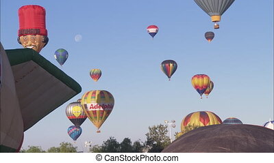 WS Hot Air Balloons - WS of hot air balloons rising into the...