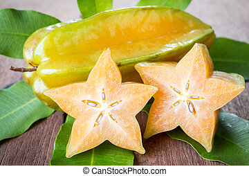 star fruit - Star fruit on wood background