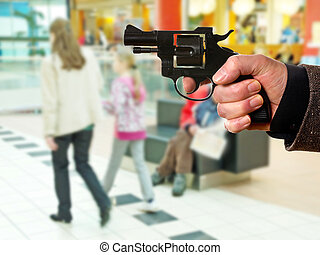 man pointing at innocent women in the supermarket
