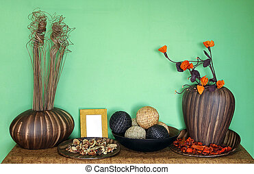 Green wall decor - Home interior decorative objects in front...