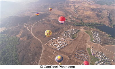 WS Hot Air Balloons overhead - WS of a handful of hot air...