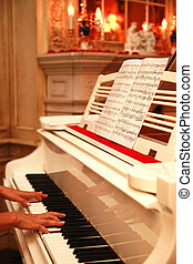 Grand piano - Woman playing the white piano in an interior