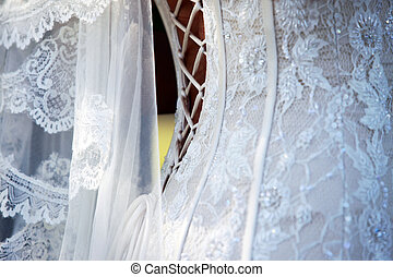 Wedding dress and veil - Detail of white wedding dress and...