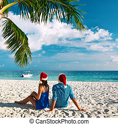 Couple in blue clothes on a beach at christmas - Couple in...