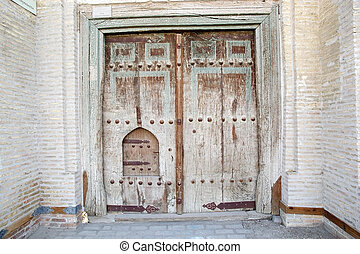 Bukhara - Ancient wooden door in the historic centre of...