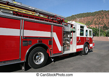 Fire Engine - Bright red fire engine used to respond to...
