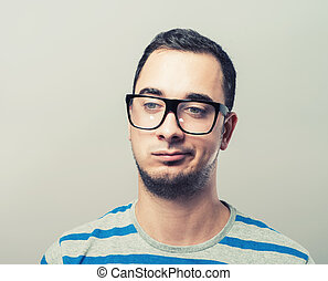 Resentful young man in glasses - Thoughtful sceptical young...