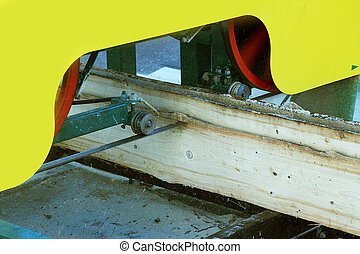 bandsaw - Small portable bandsaw sawmill being used to cut a...