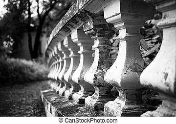 Old stone balustrade in the park closeup