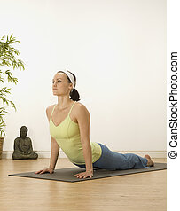 Upward dog  - woman in a traditional yoga pose