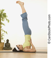 Inversion Practice  - woman in a traditional yoga pose