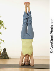 Head Stand - woman in a traditional yoga pose