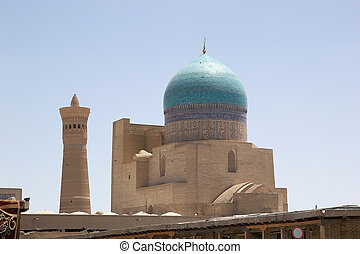 Bukhara - The dome of the mosque and mionaret at the...