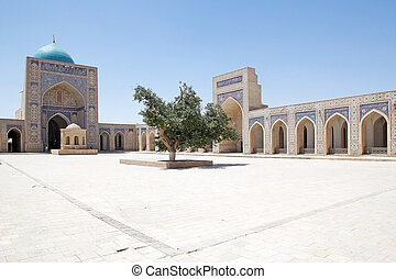 Bukhara - The courtyard at the Kalyan Mosque at the...