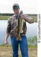 Walleye trophy catch - Fisherman holding up a trophy catch...