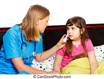 Stuffy Little Nose - Pediatrician administrating nasal spray...