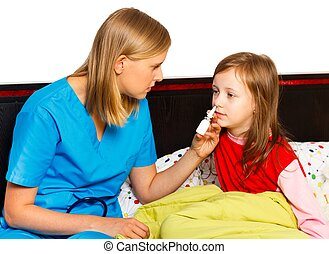 Stuffy Nose - Pediatrician administrating nasal spray for...