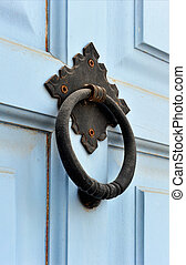 Door knocker - An old weathered door knocker from a light...