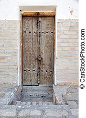 Bukhara - Old carved wooden door in the historic centre of...