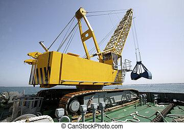 Floating dredging platform on the sea