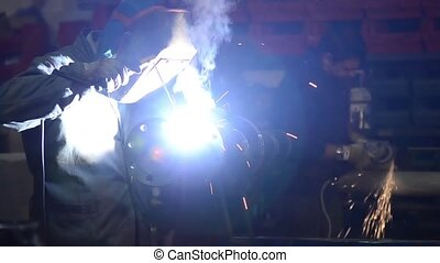welding - Welder at work in factory, industrial details