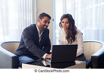 Business couple - Young business couple meeting with tech...