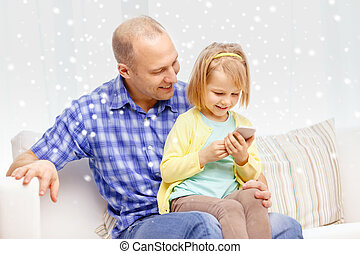 happy father and daughter with smartphone - family,...