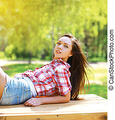 Young sensual pretty girl in country style outdoors