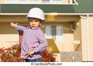Male Engineer Kid Showing Architectural House - Close up...