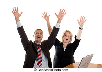businessman and businesswoman cheering in office