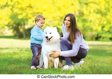 Family, leisure and people concept - mother and child...