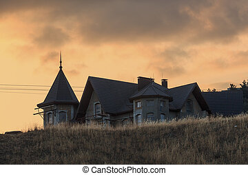 Unfinished building on the hill at sunset landscape