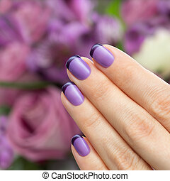 Beautiful manicure, polish is a violet color. Flower...