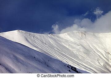 Off-piste slope in sun evening Caucasus Mountains, Georgia,...