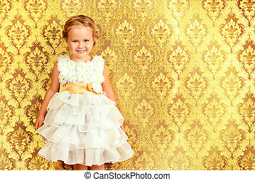 golden princess - Happy little girl in a beautiful white...