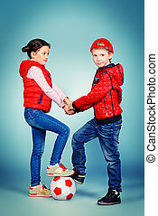 preschooler - Full length portrait of modern boy and girl...
