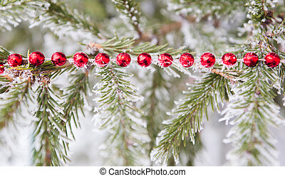 Christmas decoration on a fur-trees covered with a snow