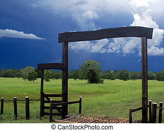 Storm Gate - A gate of a pasture in the Brazilian wetlands...