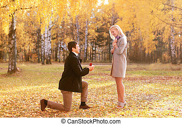 Love, couple, relationship and engagement concept - kneeled...