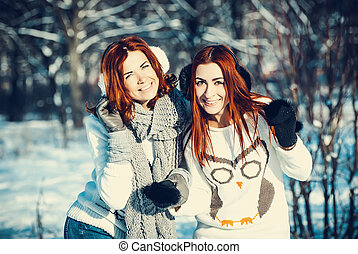two girl friends in winter outdoors