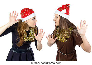 Photo of two eavesdropper young women