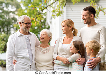 happy family in front of house outdoors - family, happiness,...
