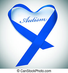 word autism and blue ribbon forming a heart - a blue ribbon...
