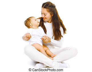 Happy mother and baby having fun on a white background