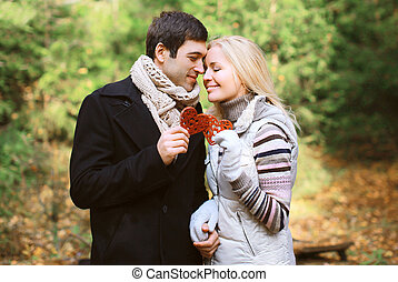 Christmas and people concept - happy pretty young couple in...