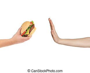 Female hand refusing the fast food meal isolated on white...